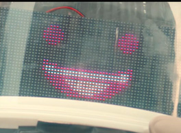 Photo image of a Smiling happy robot head